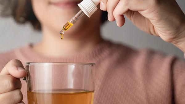 Cbd oil in tea cup